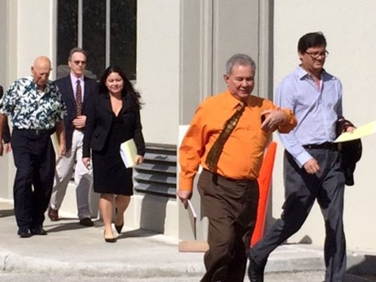 In this file photo, attorneys for plaintiffs and defendants in Guam clergy sex abuse lawsuits emerge from the U.S. District Court building after a joint status conference for cases filed in local and federal court.