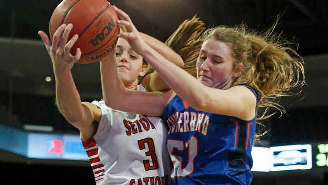 Seton's Jenn Wirth (left) battles for the rebound with Thunderbird's Brianna Lehew during a Division II semifinal at Grand Canyon University Arena in Phoenix on  Friday, Feb. 27, 2015.