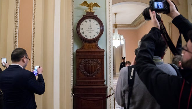 The Ohio Clock is pictured striking midnight as Senate Majority Leader Mitch McConnell tried to broker a deal with Democrats on the continuing resolution in the U.S. Capitol