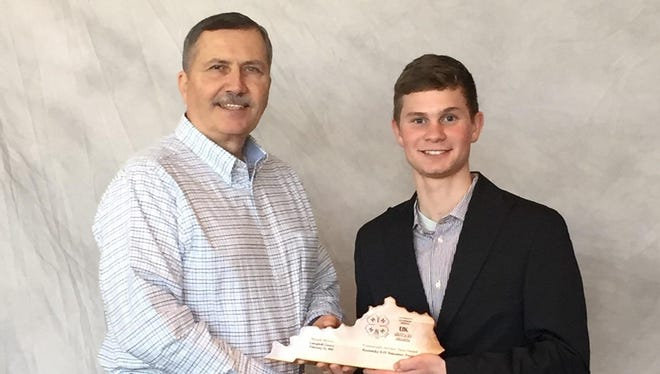 Micah Myers, right, received the Youth Award for Community Service at the 2016 Kentucky 4-H Volunteer Forum. He is shown with Owen Prim.