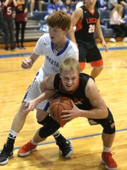Lucas' Jackson Hauger secures the basketball in front
