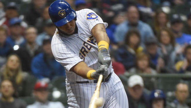 Brewers slugger Jesus Aguilar gets a pitch from Marlins reliever Junichi Tazawa squarely on the barrel of his bat and launches it over the wall in right-center field for a walk-off homer in the bottom of the ninth.