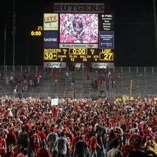 Rutgers football fans storm the field after the team upset then-No.2 South Florida on a Thursday night in 2007.