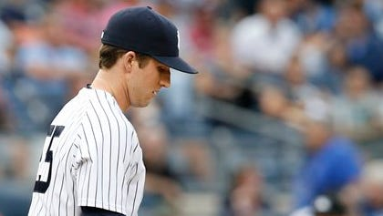 New York Yankees relief pitcher Bryan Mitchell (55) reacts during the 11th inning of the Yankees 9-5 loss to the Toronto Blue Jays in the first baseball game of a doubleheader at Yankee Stadium in New York, Saturday, Sept. 12, 2015.  (AP Photo/Kathy Willens)