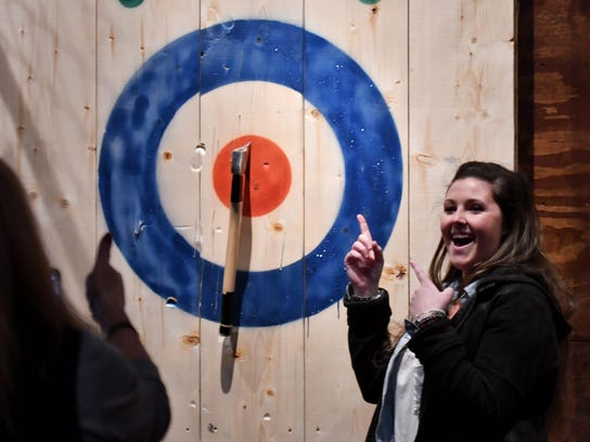 Nicole Kowalksi, 23, of Livonia celebrates a bull's-eye