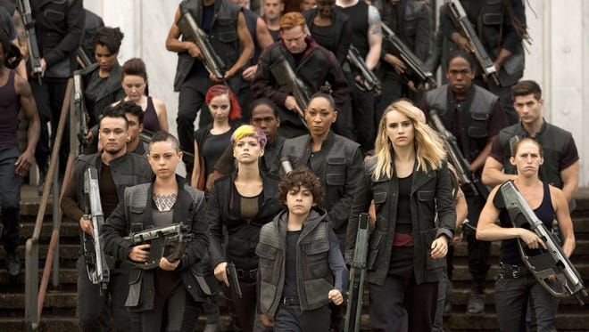 """Rebel women Rosa Salazar, foreground from left, Emjay Anthony and Suki Waterhouse appear in a scene from """"The Divergent Series: Insurgent."""""""