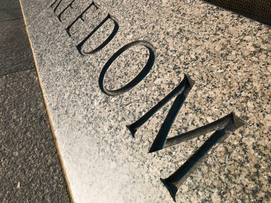 An inscription at the National World War II Memorial in Washington, D.C., is pictured here. To celebrate that freedom, Spirit of 45 in downtown Las Cruces today will mark the 70th anniversary of the end of World War II will music, dancing and food.