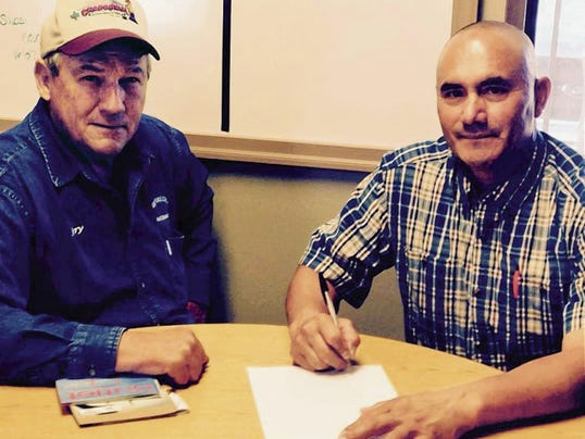 Courtesy Photo   Deming Elks Exalted Ruler Jerry Pingleton, left, and Deming Mayor Benny Jasso meet for the proclamation signing of Elks Youth Week in Deming.