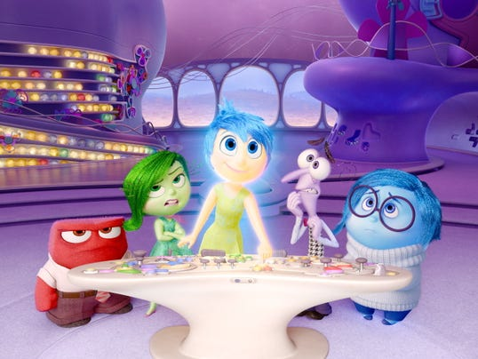 "In this file image released by Disney-Pixar, characters, from left, Anger, voiced by Lewis Black, Disgust, voiced by Mindy Kaling, Joy, voiced by Amy Poehler, Fear, voiced by Bill Hader, and Sadness, voiced by Phyllis Smith appear in a scene from ""Inside Out."" The movie releases in theaters on June 19, 2015."