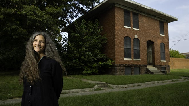 Mary Frances stands in front of what was once The Lincoln Colored Home on south 12th Street in Springfield, Ill.. Frances has produced a documentary about the life of Eva Carroll Monroe who founded the home in 1898.
