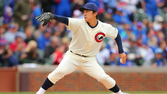 Chicago Cubs starting pitcher Tsuyoshi Wada (18) delivers a pitch during the first inning against the Kansas City Royals at Wrigley Field.