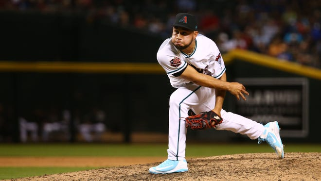 Diamondbacks pitcher Silvino Bracho throws to the Los Angeles Dodgers in the 7th inning on May 1, 2018 at Chase Field in Phoenix, Ariz.