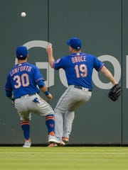 New York Mets right fielder Jay Bruce (19) and left