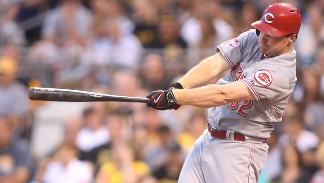 Cincinnati Reds right fielder Jay Bruce (32) singles against the Pittsburgh Pirates.
