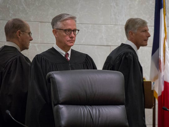 Chief Justice Mark S. Cady, center, is picturedbefore