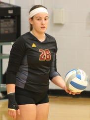 Freshman setter Julia Bishop prepares to serve against