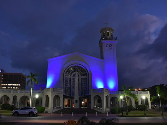 The Dulce Nombre de Maria Cathedral-Basilica in Hagåtña is illuminated with blue lights on April 5, 2017, in honor of  Autism Awareness Month, Sexual Assault Awareness Month and Child Abuse Prevention Month.
