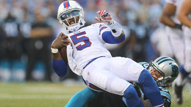 Bills quarterback Tyrod Taylor is pulled down from behind by Carolina's A.J. Klein.