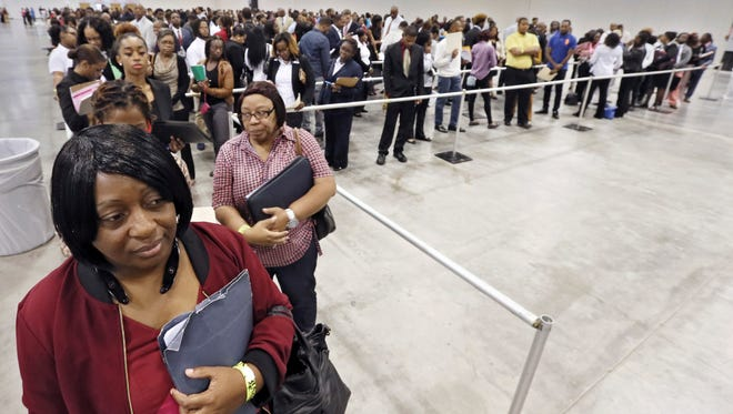 Hiring has picked up this year, a trend that's making for bustling job fairs