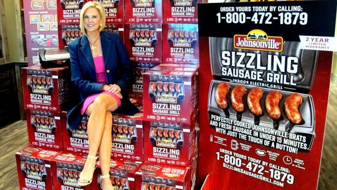 """Naples """"mom-preneur"""" Shelly Stayer poses for a portrait Wednesday, May 4, 2016, on a display of her newly launched Sizzling Sausage Grills at Johnsonville Sausage Marketplace in North Naples."""
