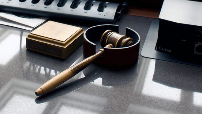 A gavel sits on a desk.
