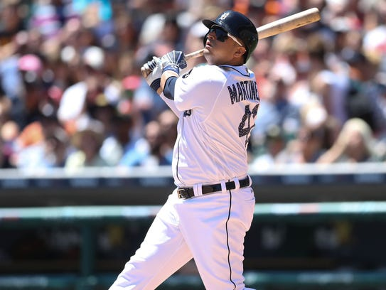 Detroit Tigers Victor Martinez singles against the