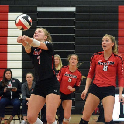 Muskego senior #7, Julia Van Fleet digs the ball on a serve from Franklin in the 2ed of the WIAA varsity girls volleyball regional finals at Muskego,  Saturday evening, October 22, 2016. Also pictured are Muskego junior #5, Olivia Kudronowicz and senior #8, Haley Bartz.