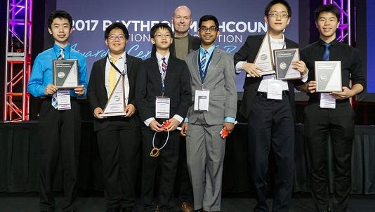 Coach Mark Martin (rear) with his fifth-place Michigan team at the 2017 national Mathcounts competition in Florida. In front, from left, are assistant coach Freddie Zhao, team members Reagan Choi, Jeffrey Zhang, Varun Rajesh, and Alex Xu, and assistant coach Spencer Liu.