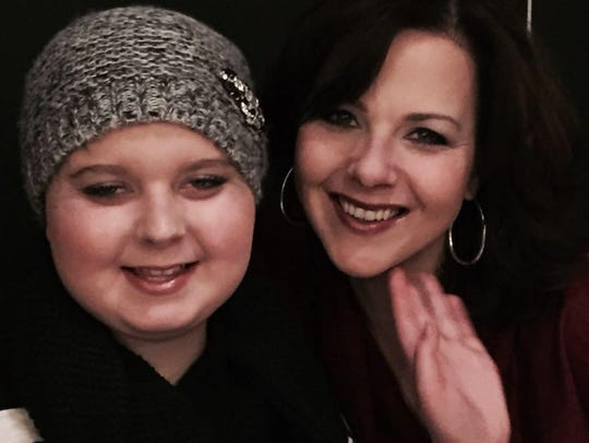 Kari Rhinehart, right, and her daughter Emma Findley,