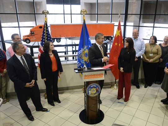 Lt. Gov. Rebecca Kleefisch is introduced by Paul Kardish, center, the general counsel at Schneider, to a group of employees and media Thursday during her tour of the company in Ashwaubenon. She announced that she will be taking part in a trade mission to China.