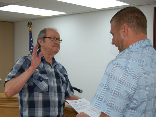 Norfork alderman Phillip Stultz is sworn in Tuesday by Justice of the Peace Ty Chapman at City Hall.