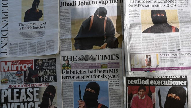 "An arrangment of British daily newspapers photographed in London on Feb. 27, 2015 shows the front-page headlines and stories regarding the identification of the masked Islamic State group militant dubbed ""Jihadi John""."