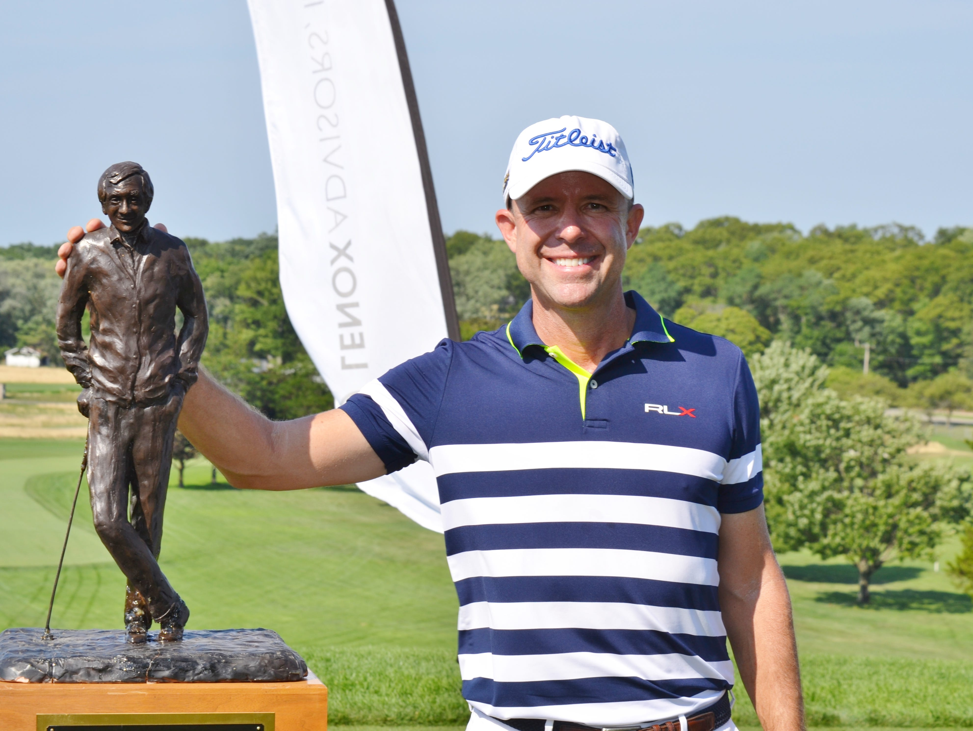 Rob Labritz poses with the trophy after winning the New York State Open on Thursday at Bethpage State Park's Black Course.
