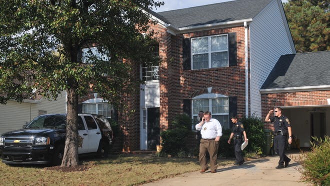 Spartanburg County sheriff's deputies search the home of registered sex offender Todd Kohlhepp on Nov. 3, 2016, in Moore, S.C., after a woman was found chained in a storage container on property that Kohlhepp owns.