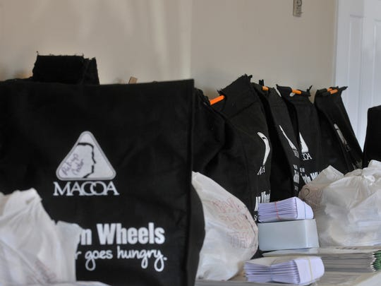 Items are sitting ready for Meals on Wheels volunteers to deliver in Montgomery on Tuesday, March 17, 2015. The Montgomery Area Council on Aging is participating in the 13th annual National March for Meals.