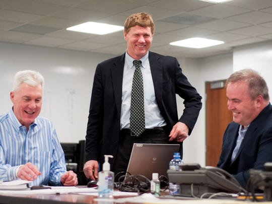 From left, Green Bay Packers general manager Ted Thompson shares a laugh with team president and CEO Mark Murphy and coach Mike McCarthy in the draft room at Lambeau Field in April 2013.