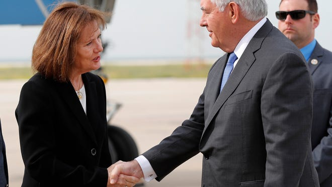 U.S. Ambassador to Lebanon Elizabeth Richard, left, shakes hands with Secretary of State Rex Tillerson, right, upon his arrival at Rafik Hariri international airport, in Beirut, Lebanon, Feb. 15, 2018. Tillerson was in Beirut for one day visit to meet with Lebanese officials.