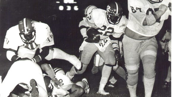 Marcus Dupree gets a block from a teammate in a high school football game in the 1980s. Dupree, a high school football star at Philadelphia High School who later played for Oklahoma, the New Orleans Breakers and the Los Angeles Rams.