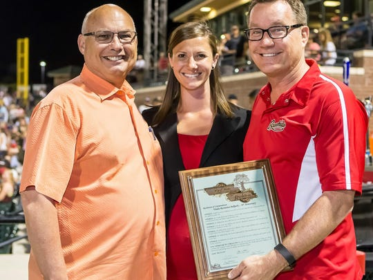 Visalia Mayor Steve Nelsen presented a plaque to Rawhide administrators during the anniversary ceremony Saturday.