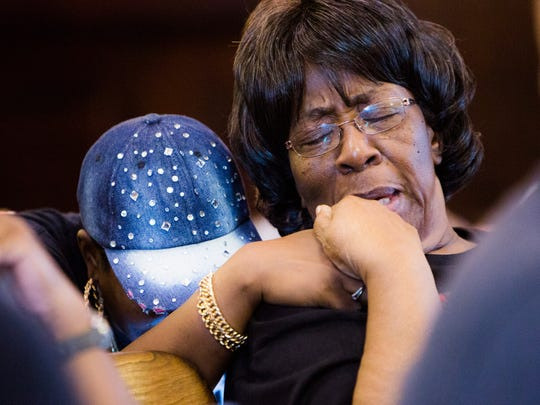 Mary Mackey, Pat Charles Mackey's mother, prays with Traci Fant of Freedom Fighters before speaking to the Anderson County Council to plead with the county to intervene in the investigation of Mackey's death on Tuesday, October 18, 2016.