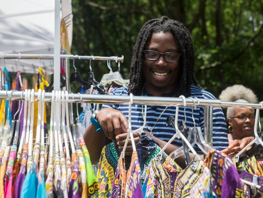 Michael Jones of Knoxville looks at colorful clothing
