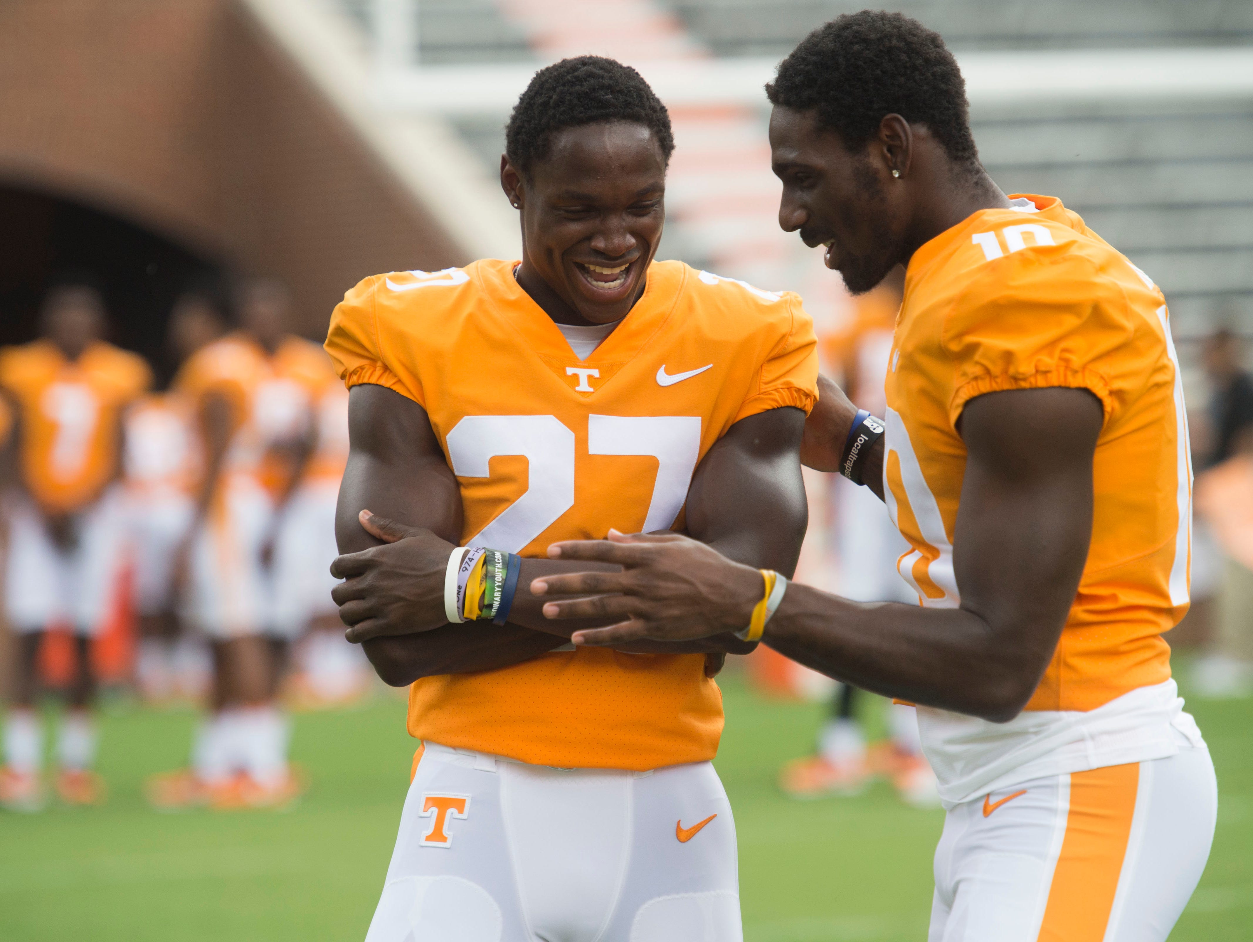 Tennessee running back Carlin Fils-aime (27), left, and wide receiver Tyler Byrd (10 during Media Day at Neyland Stadium.