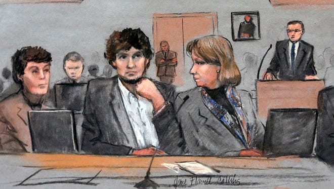 In this March 5, 2015 file courtroom sketch, Dzhokhar Tsarnaev, center, is depicted between defense attorneys Miriam Conrad, left, and Judy Clarke, right, during his federal death penalty trial in Boston.  Prosecutors rested their case against Tsarnaev on Monday, March 30, 2015, after jurors saw gruesome autopsy photos and heard a medical examiner describe the devastating injuries suffered by the three people who died in the 2013 terror attack.