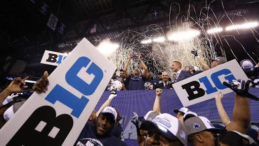 Dec 3, 2016; Indianapolis, IN, USA; Penn State Nittany Lions head coach James Franklin and his team celebrate after defeating the Wisconsin Badgers the Big Ten Championship college football game at Lucas Oil Stadium. Mandatory Credit: Brian Spurlock-USA TODAY Sports