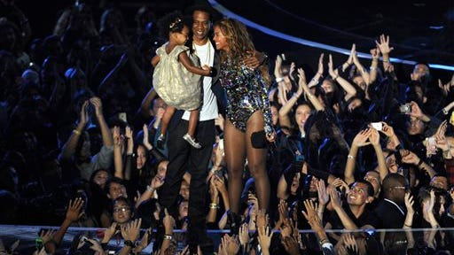 Beyonce on stage hugs Jay Z and their daughter Blue Ivy as she accepts the Video Vanguard Award at the MTV Video Music Awards at The Forum on Sunday, Aug. 24, 2014, in Inglewood, Calif.