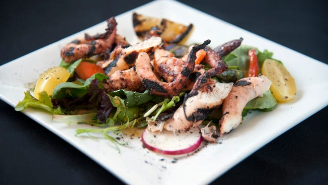 A home run at Braise 116 in Haddonfield is the Grilled Octopus ($12) , which is is impeccably cooked. First, it's braised slowly in white wine, and then marinated in lemon, yogurt and olive oil, Greek flavors. It's then grilled before being served on a pile of salad greens with cherry tomatoes and a wedge of charred lemon.