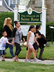 People arrive at the Church of St. Rose in Belmar Friday, June 16, 2017, before a memorial service for the 13-year-old girl who died and the 12-year-old girl who is on life support after the pair were found facedown in the ocean between the 9th and 11th Avenue beaches in the ocean.