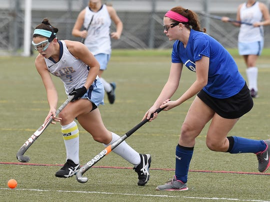 Cape's Tess Bernheimer moves the ball downfield as Cape Henlopen High School (white) hosted Brandywine HS (blue) in the 1st round of the Delaware State HS Hockey Tournament at the school near Lewes on Wednesday November 11.