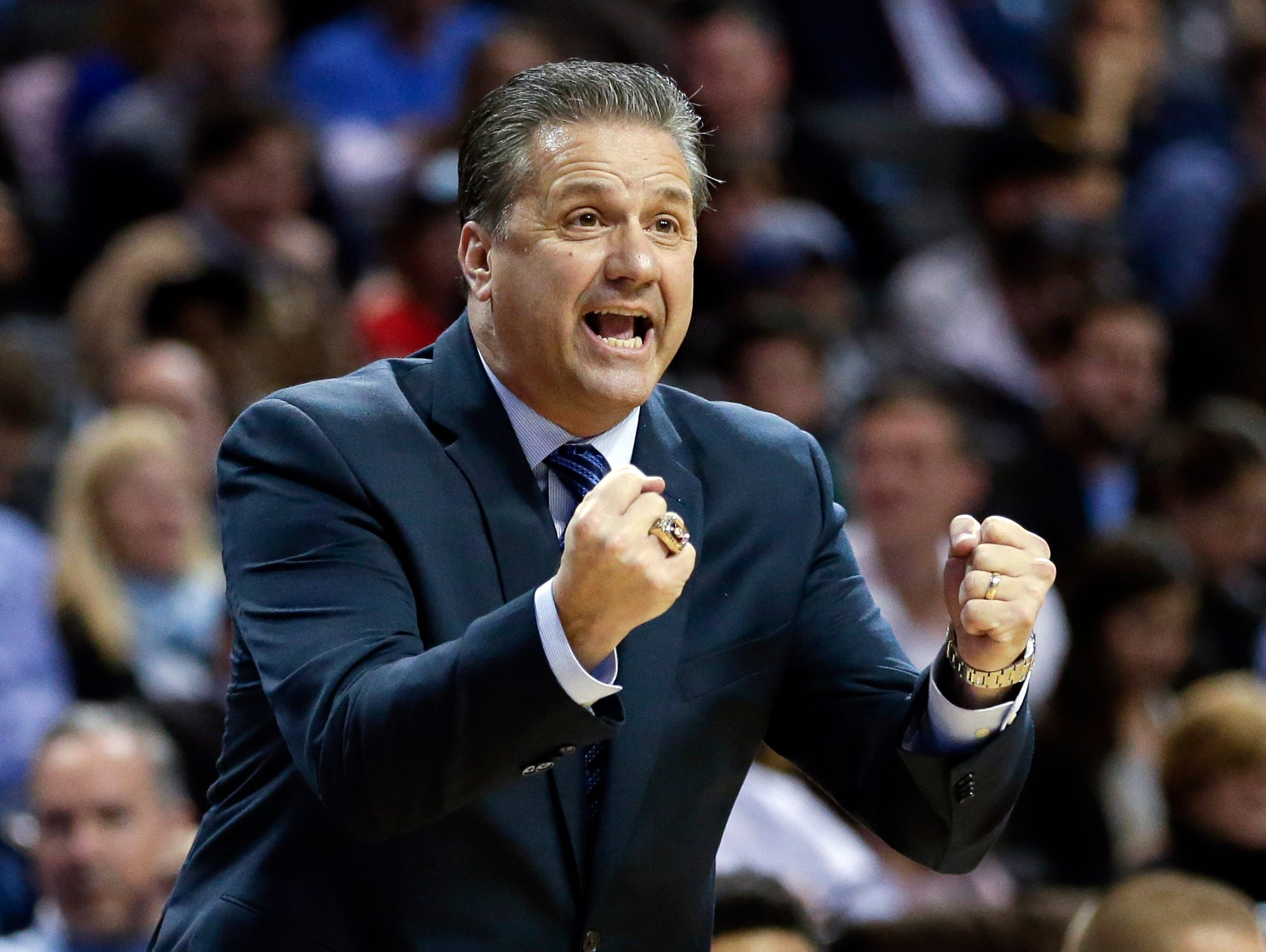 Kentucky head coach John Calipari calls out to his team during the first half of an NCAA college basketball game against Ohio State Saturday, Dec. 19, 2015, in New York. (AP Photo/Frank Franklin II)