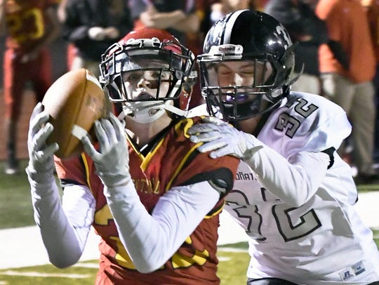 Centennial's Lance Frost hauls in this pass in the